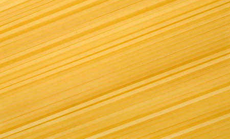 farinaceous: Uncooked spaghetti as abstract background Stock Photo
