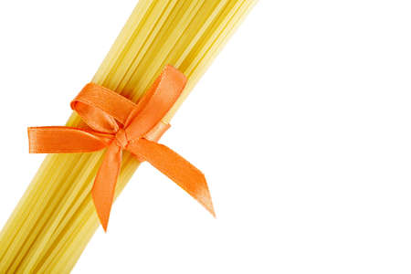 farinaceous: Pile of spaghetti tied with ribbon Stock Photo