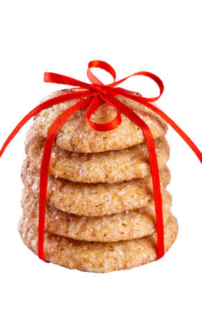 Pile of ginger cookies tied with red ribbon isolated on white