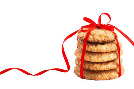 Stack of christmas gingerbread cookies tied with red ribbon isolated on white photo