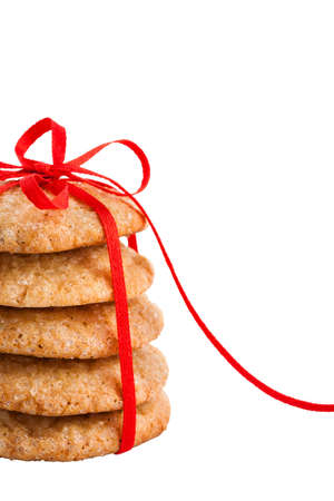 Stack of christmas gingerbread cookies tied with red ribbon isolated on white