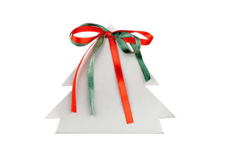 Paper christmas tree with green and red ribbons isolated photo