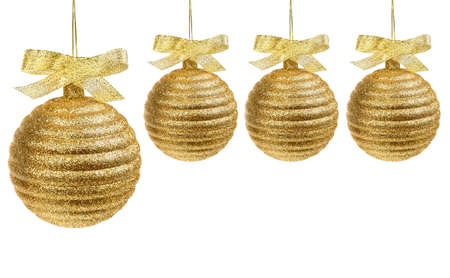 Four golden christmas balls with golden ribbon isolated on white