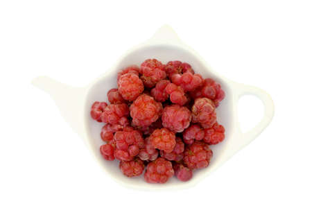 Raspberry on a teapot shaped plate isolated on white background Stock Photo
