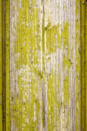drab: Old wooden board with flaked green paint