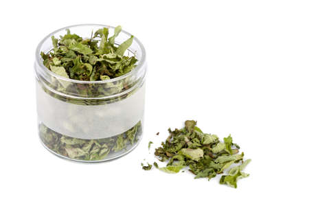 Dried mint in glass jar isolated on white Stock Photo