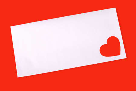 Envelop with red heart on red background photo