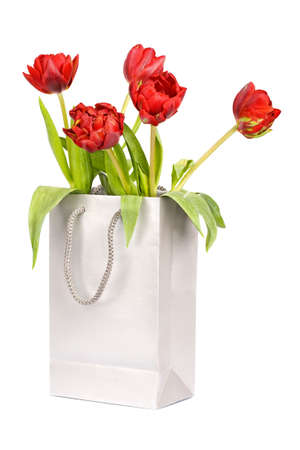 Five red tulips in silver paper bag isolated on white Stock Photo