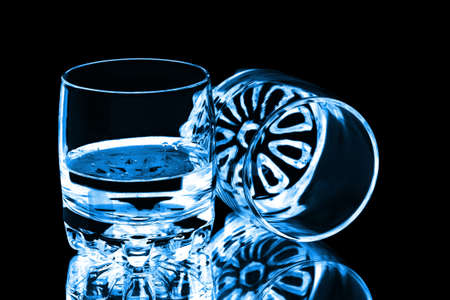 glass half full: Two glasses isolated on black Stock Photo