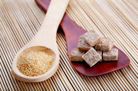 Wooden spoons with different kinds of brown sugar Stock Photo