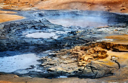 the stinking: Mudpots at the geothermal area Hverir, Iceland  Stock Photo