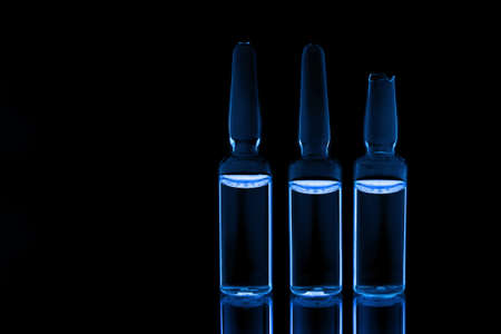 ampules: Three medical ampules on black background