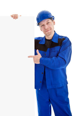 white hat: The worker in blue uniform and safety helmet pointing on blank sign billboard, isolated on white