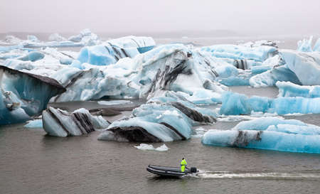 Inflatable boat in the Jokulsarlon Glacier Lagoon, Southern Iceland Stock Photo