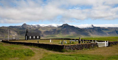 Black wooden church and small cemetary in Budir, Snaefellsnes peninsula, Western Iceland