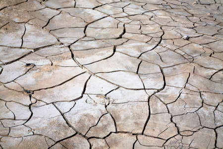 Cracked and dried mud dirt texture background in the desert Stock Photo