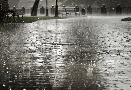 heavy rain: Dark grey city streets during heavy rain  Stock Photo
