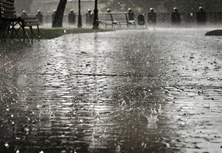 rainfall: Dark grey city streets during heavy rain  Stock Photo
