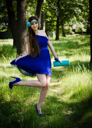 prom queen: Beauty in blue dress happy in the park