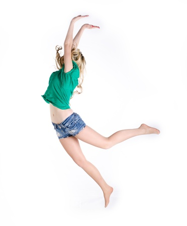 Girl jumping on white background photo