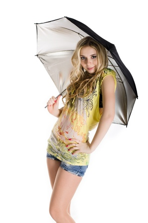 Girl with reflective silver umbrella isolated on white. photo