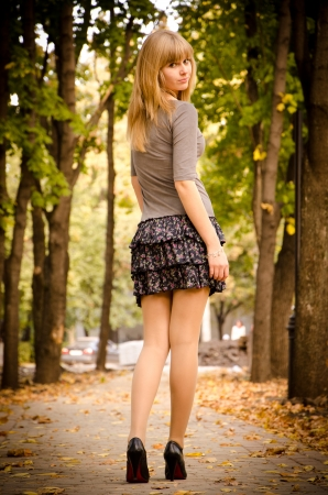 Full size autumn portrait of a beautifuk girl looking back.