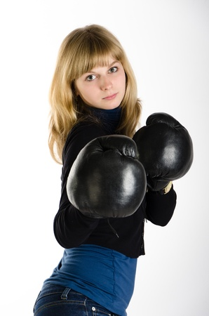Girl in boxing gloves  on white background Stock Photo