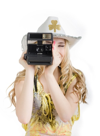 Girl and a polaroid camera. Portrait on white background with flash. photo