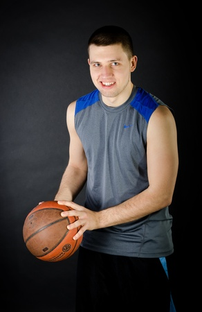 Basketball Player portrait on dark background. photo