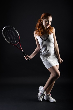 Tennis girl on dark background Stock Photo - 14826804