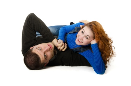 Couple in love hugging, White studio background. photo