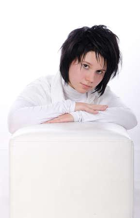 Pure white studio portrait with a cube  Stock Photo