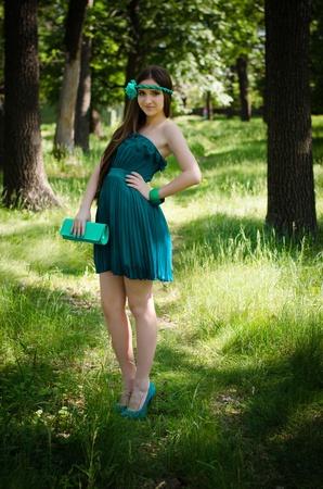 Beauty in green dress happy in the park