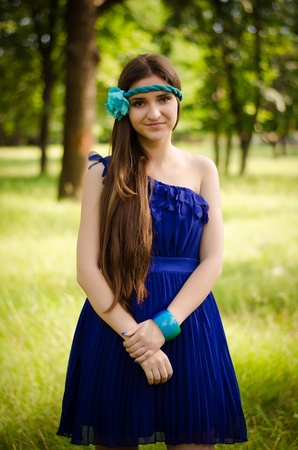 Beauty in blue dress happy in the park
