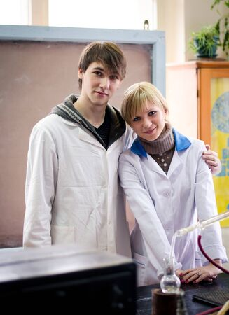 Happy students in a chemical lab