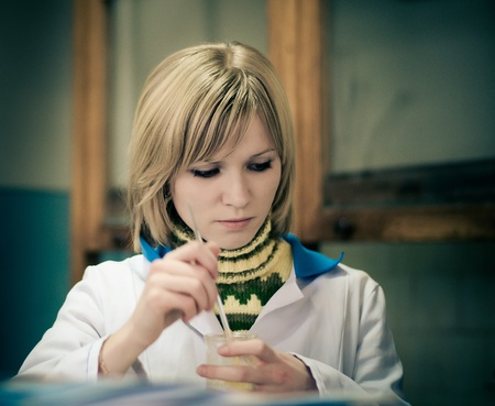 Beautiful female student in chemical laboratory