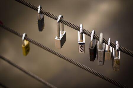 Line of padlocks on a metal rope Stock Photo