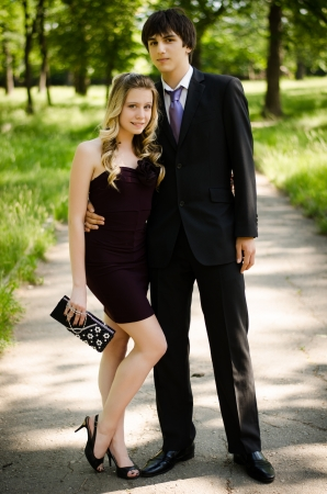 Young couple of high school seniors after the prom in a summer park  Stock Photo - 17544684