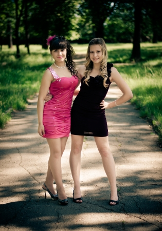 Two girls after prom in a summer park. photo