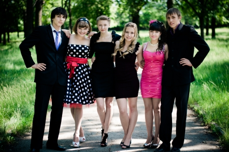 formal dress: Six best friends smiling happy in a summer park. Stock Photo
