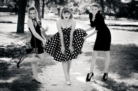 Girls lifting their friends skirt photo