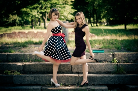 Beautiful girls posing in a summer park photo