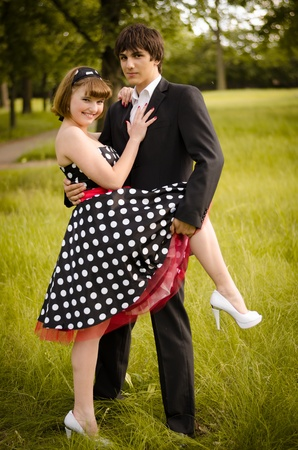 Young teen couple after the prom in a park.