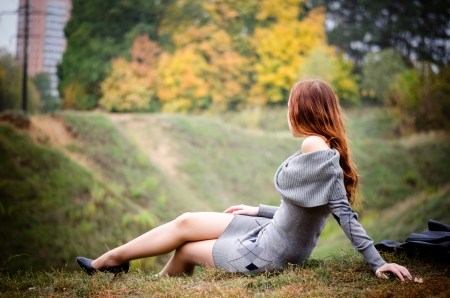 Beautiful girl in an autumn park looking away photo