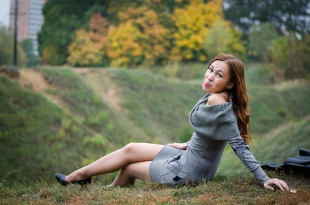 Beautiful girl in an autumn park
