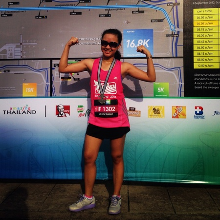 sponsors: an ironwoman who just finished a marathon with her medal..