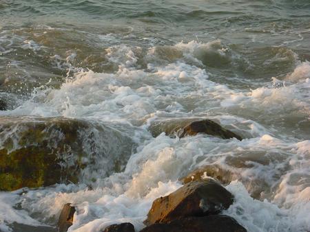 waves crashing: waves crashing rocks