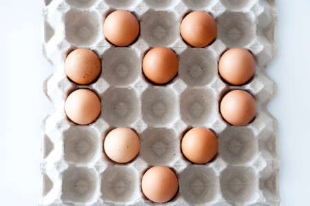 arranged: eggs in the tray arranged form LOVE pattern.
