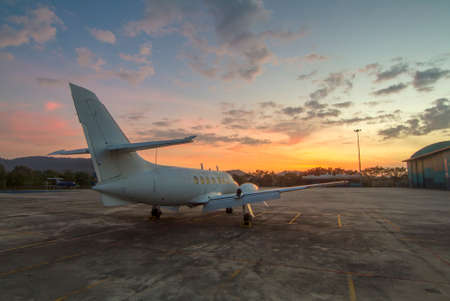industry moody: Small aircraft at the beautiful sunrise Stock Photo