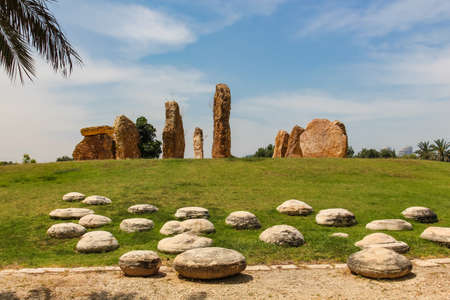 stone pillars stand in a circle in a park in Israel 免版税图像